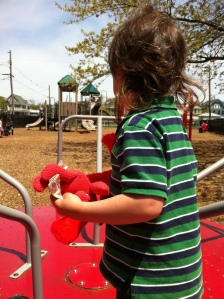 The closest he has to a sibling is an Elmo doll.